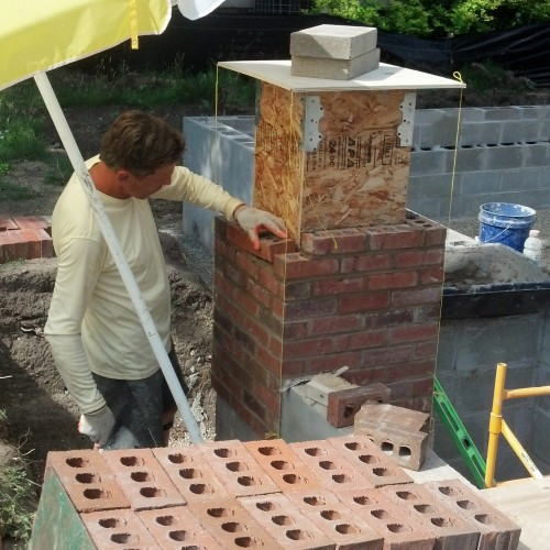 Mel carefully laying brick for the porch columns.