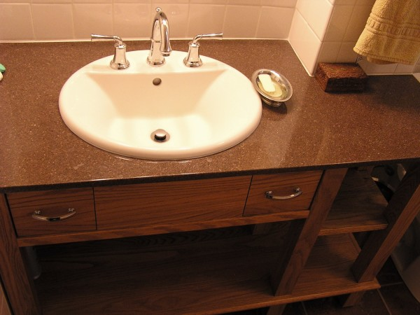 This vanity was custom crafted by Mel to fit the contours of the wall