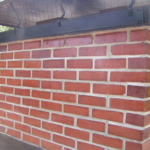 After: tuck pointing & rebuilding a chimney